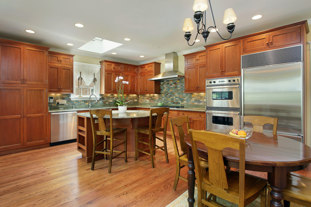 Kitchen with circular island and eating area